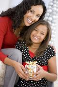 Mother Giving Daughter Her Christmas Present Stock Photos