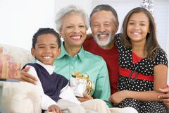 Children With Grandparents At Christmas - stock photo
