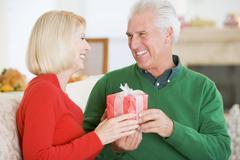 Mature Couple At Christmas Stock Photos