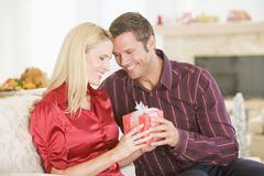 Couple Sharing Christmas Present - stock photo