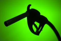 Fuel Pump Silhouette Against A Green Background Stock Photos