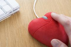 Heart-Shaped Computer Mouse - stock photo