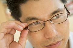 Man Looking Through New Glasses Stock Photos