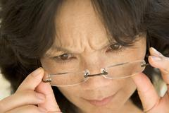 Woman Looking Through New Glasses Stock Photos