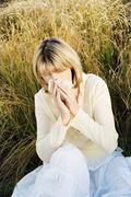 Woman Blowing Her Nose - stock photo