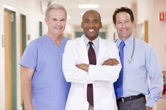 Doctors Standing In A Hospital Corridor Stock Photos