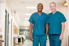 Two Orderlies Standing In A Hospital Corridor Stock Photos