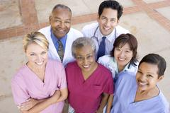 High Angle View Of Hospital Staff Standing Outside A Hospital - stock photo