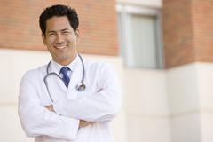 Stock Photo of Doctor Standing Outside A Hospital