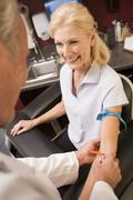 Middle Aged Woman Having Blood Test Done Stock Photos