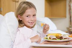 Young Girl Eating Hospital Food - stock photo