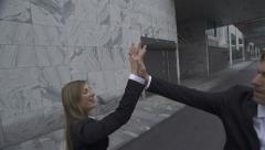 Business people giving high-five to each other Stock Footage