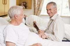 Doctor Checking Up On Senior Man Stock Photos