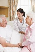Doctor Talking To Senior Man And His Wife Stock Photos