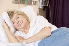 Senior Woman Lying In Hospital Bed - stock photo