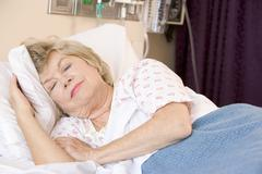 Senior Woman Sleeping In Hospital Bed Stock Photos
