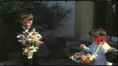 Vintage 8 mm film: Children with flowers, Germany, 1960s Stock Footage
