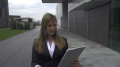 Young businesswoman gets good news over digital tablet Stock Footage