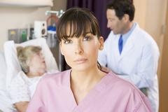 Nurse Standing In Hospital Room,Doctor Talking To Patient - stock photo