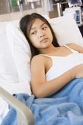 Stock Photo of Young Girl Lying In Hospital Bed