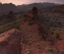 Wide Vista as couple hikes across landscape Capitol reef national Park Stock Footage