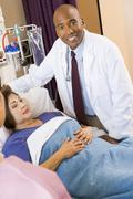 Doctor Talking To Senior Woman - stock photo