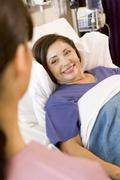 Senior Woman Lying In Hospital Bed,Smiling - stock photo