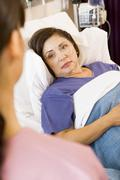 Patient Lying In Hospital Bed - stock photo
