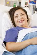 Senior Woman Smiling,Lying In Hospital Bed Stock Photos