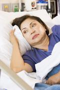 Senior Woman Lying Down In Hospital Bed Stock Photos