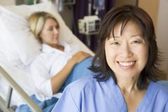 Doctor Standing In Patients Room,Smiling Stock Photos