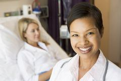 Nurse Standing In Patients Room Stock Photos