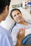 Doctor And Patient Talking To Each Other Stock Photos