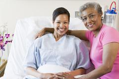 Mother And Daughter Smiling In Hospital - stock photo