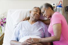 Senior Couple Embracing In Hospital - stock photo