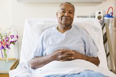 Senior Man Sitting In Hospital Bed - stock photo