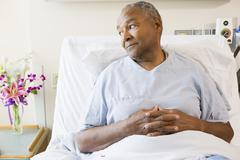 Senior Man Sitting In Hospital Bed Stock Photos