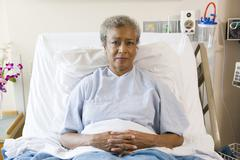 Senior Woman Sitting In Hospital Bed Stock Photos