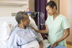 Nurse Talking To Senior Woman - stock photo