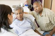 Stock Photo of Doctor Talking To Senior Couple