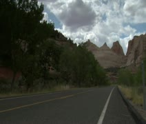 Jib shot of three motorcycles passing camera in Capitol reef national Park Stock Footage