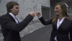 SLOW MOTION: Businessman and businesswoman fist bump - stock footage