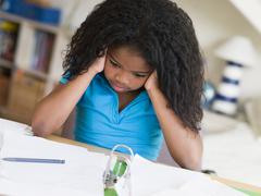 Young Girl Doing Homework - stock photo