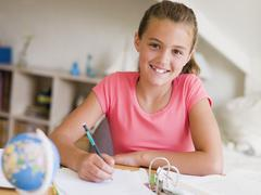 Young Girl Doing Her Homework Stock Photos