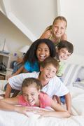 Five Young Friends Lying On Top Of Each Other - stock photo