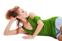 Young beautiful woman lying on the floor Stock Photos