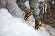 Stock Photo of pair of alpinist boots in crampons