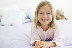 Young Girl Lying On Her Bed In Her Pajamas - stock photo