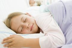 Young Girl Asleep In Her Bed Stock Photos