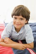 Young Boy Lying Down On His Bed Stock Photos